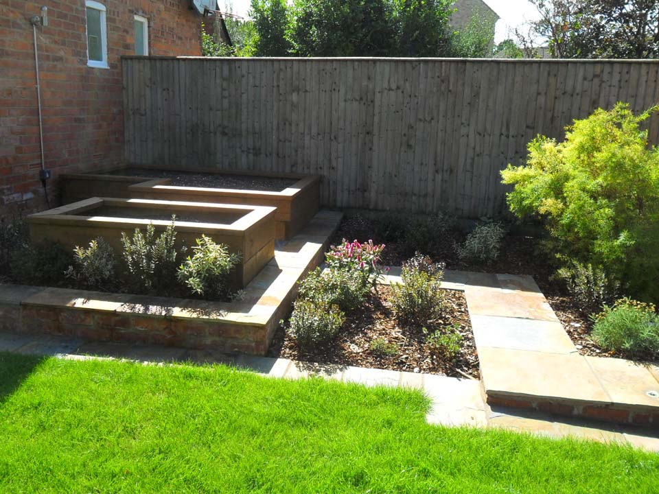 Raised beds compost bins ammonite paving landscaping for Garden design gloucestershire